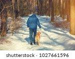 A Man With A Labrador Retrieve...
