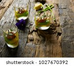 snack from salmon and puree... | Shutterstock . vector #1027670392