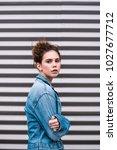 model in denim jacket on... | Shutterstock . vector #1027677712