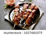 tasty pork skewers  bbq meat on ... | Shutterstock . vector #1027681075