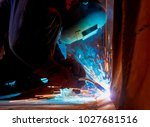 welder working at the factory ... | Shutterstock . vector #1027681516