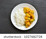 chicken curry with rice on...   Shutterstock . vector #1027682728