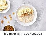 dish for breakfast. oats... | Shutterstock . vector #1027682935