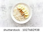 oats porridge with banana... | Shutterstock . vector #1027682938