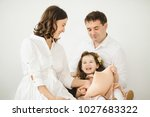 pregnant woman  her man and... | Shutterstock . vector #1027683322