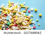colorful pills on a blue... | Shutterstock . vector #1027688062