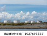oil tanks in a row under blue... | Shutterstock . vector #1027698886