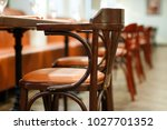 wooden table served with plates ... | Shutterstock . vector #1027701352