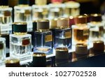 many different perfums in a... | Shutterstock . vector #1027702528