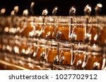 a lot of delicious caramel in... | Shutterstock . vector #1027702912