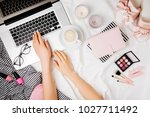 young woman freelancer working... | Shutterstock . vector #1027711492