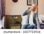 happy woman at the hotel room ... | Shutterstock . vector #1027723516