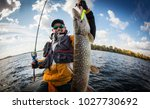 fishing. fisherman and trophy... | Shutterstock . vector #1027730692
