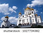 white building with golden... | Shutterstock . vector #1027734382