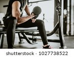 cropped shot of fitness man... | Shutterstock . vector #1027738522