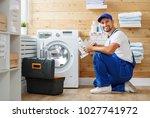 working man plumber repairs a... | Shutterstock . vector #1027741972