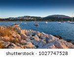 fishing boats in the morning... | Shutterstock . vector #1027747528