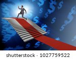 young businessman climbing... | Shutterstock . vector #1027759522