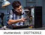 man repairing computer desktop... | Shutterstock . vector #1027762012