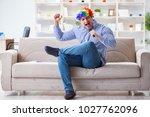funny man singing songs in... | Shutterstock . vector #1027762096