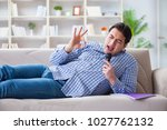 funny man singing songs in... | Shutterstock . vector #1027762132