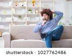 funny man singing songs in... | Shutterstock . vector #1027762486
