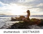 attractive woman meditating... | Shutterstock . vector #1027764205