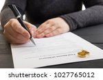 hands of wife  husband signing... | Shutterstock . vector #1027765012