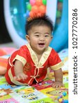 8 month old baby wearing a red... | Shutterstock . vector #1027770286