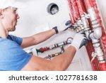 professional plumber work.... | Shutterstock . vector #1027781638