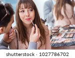 man doing make up for cute... | Shutterstock . vector #1027786702