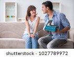 young woman getting pet rabbit...   Shutterstock . vector #1027789972