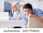 doctor examining x ray images... | Shutterstock . vector #1027790032