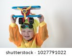 funny kid in sunglasses with... | Shutterstock . vector #1027791022