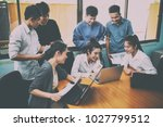 team at work  group of asia... | Shutterstock . vector #1027799512