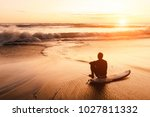 surfer sits on his board near... | Shutterstock . vector #1027811332