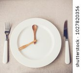 white plate with knife and fork ... | Shutterstock . vector #1027820356