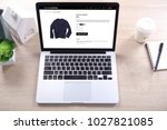 blue navy sweater on ecommerce... | Shutterstock . vector #1027821085