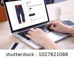 people buying blue navy jeans... | Shutterstock . vector #1027821088
