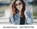 a beautiful young girl with...   Shutterstock . vector #1027823746