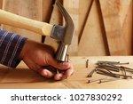 hammer hitting the finger do... | Shutterstock . vector #1027830292