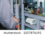 electrician specialist checking ... | Shutterstock . vector #1027876192