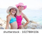 little girls playing on the... | Shutterstock . vector #1027884106