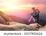 biker riding on bicycle in...   Shutterstock . vector #1027902616
