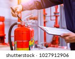 engineer checking industrial... | Shutterstock . vector #1027912906