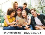friends in the park using a... | Shutterstock . vector #1027936735