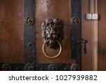 door knocker as a lion on a... | Shutterstock . vector #1027939882