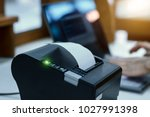 cashier are recording sales... | Shutterstock . vector #1027991398