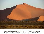 sand dune at sunrise in the... | Shutterstock . vector #1027998205