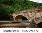 stone bridge by water | Shutterstock . vector #1027998472